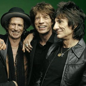 Ronnie Wood Twisting Arms for a Rolling Stones Glastonbury Appearance