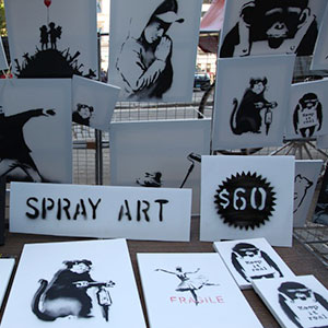 Banksy's Unpublicized Art Stand Sells Signed, Original Canvases for $60
