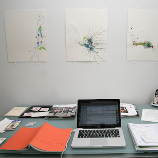 Photographer Takes Pictures of Artists Desks, Clutter, Cats...