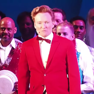 """Watch Conan O'Brien Sing <i>The Simpsons</i>' """"Monorail Song"""" Live"""