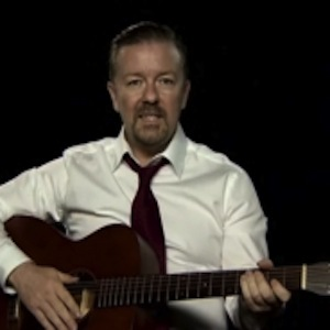 Watch Ricky Gervais Give His First Guitar Lesson as <i>The Office's</i> David Brent