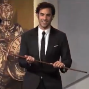 Watch Sasha Baron Cohen Push an Old (Stunt) Woman off the Stage at the Britannia Awards