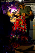 Jason Hammel works on the backdrop for the performance at the Drunken Unicorn.
