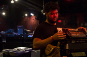 James Felice works on his excelsior accordian before soundcheck.