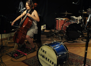 Neyla Pekarek warms up on the cello at the SHIRK music + sound studio for a HearYa live session.