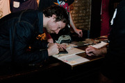 Alex Brown Church signs a CD for a fan after the show at Lincoln Hall.