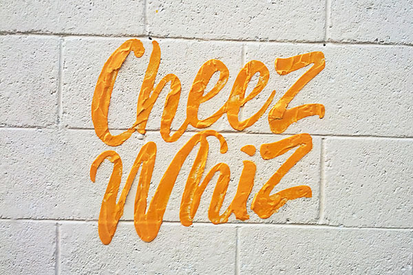 Artist Creates Street Art Typography From Cheez Whiz, Nutella, Toothpaste