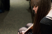 Klara Söderberg plays the guitar in the green room of The Buckhead Theater before taking the stage for their second to last stop on their tour with Lykke Li.