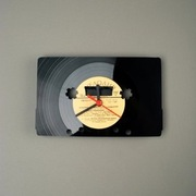 "<a href=""http://www.pavel-sidorenko.com/page/sale/shop-revinyl"">RE_VINYL Wall Clock (Pavel Sidorenko, $51)</a>"
