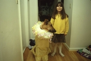 Madi Diaz trying out costume on her dog