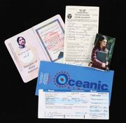 Sayid's passport, Oceanic boarding pass and photo of Nadia
