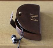 Saddle Leather Earphone Case by Pottery Barn | $15.50 | Keep passengers' earbuds seperate with these monogrammable cases.