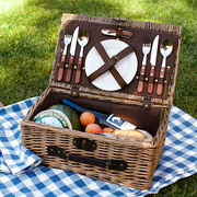 Rattan Picnic Basket For 2 by Pottery Barn | $89 | This basket includes plates, wine glasses, flatware and a wine opener.