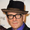 "Watch Elvis Costello Cover ""Purple Rain"""