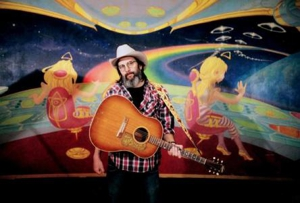 Steve Earle is on the road again