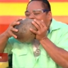 Man Husks Coconuts with His Teeth
