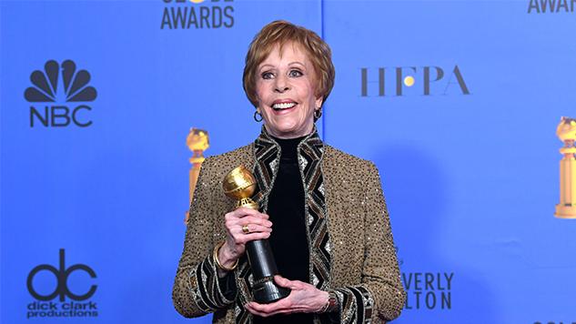 Carol Burnett holding an award
