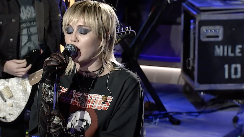 "Watch Miley Cyrus Cover Hole's ""Doll Parts"" on <i>The Howard Stern Show</i>"