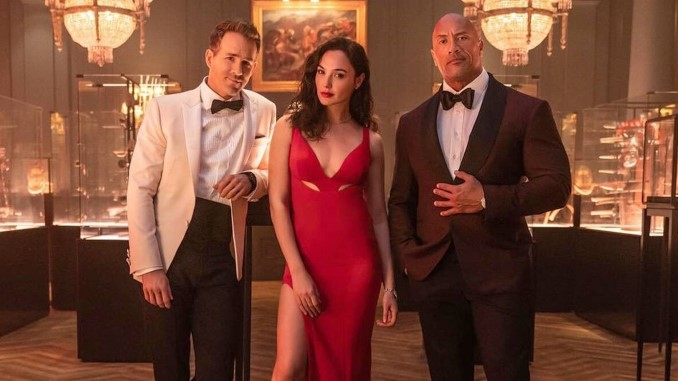 """The Rock and Ryan Reynolds are """"Work Wives"""" in First Trailer for Netflix's <i>Red Notice</i>"""