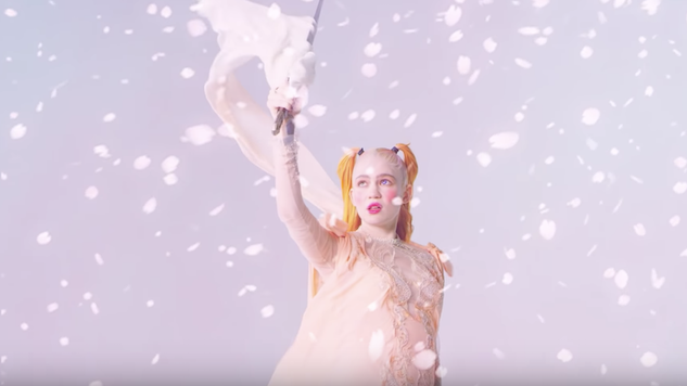 "Watch Grimes' New ""Idoru"" Video, Complete with Aggressive Pastels and Anime"