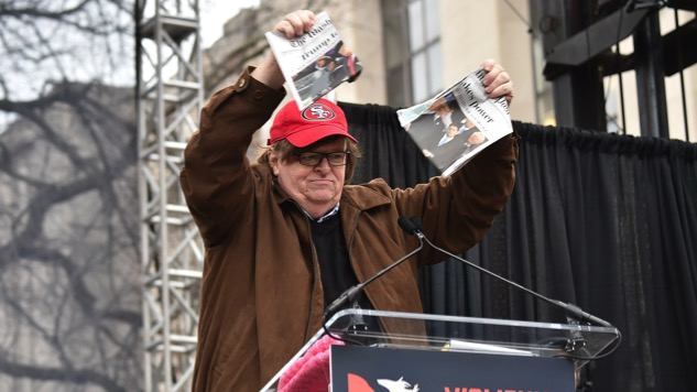 Michael Moore Rips Up a Copy of <i>Washington Post</i> at Women's March