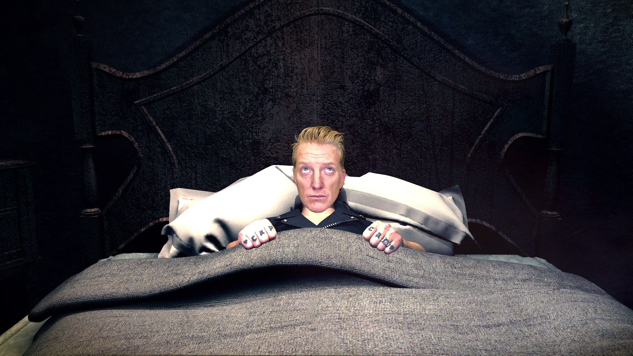 """Queens of the Stone Age Get All Sorts of Spooky in Frenetic """"Head Like A Haunted House"""" Video"""