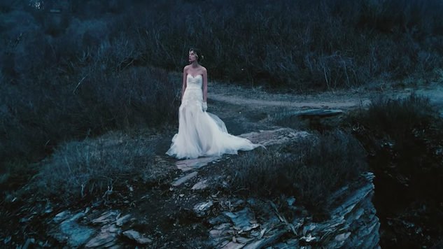 "Wolf Alice's Ellie Rowsell Plays a Fleeing Bride in ""Space & Time"" Video"
