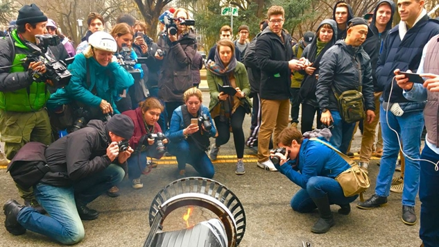 What Does It Say About the Media When They Flock to Photograph a Small Flame Contained within a Trash Can?