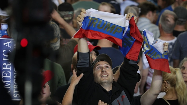 Protester Throws Russian Flags at Trump: 'We Should Be Talking About Treason'