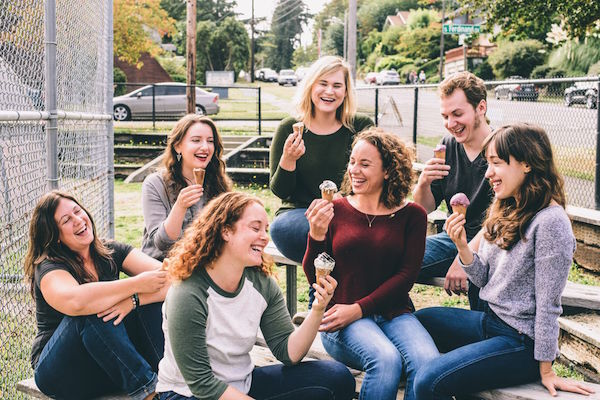 women laughing together with ice cream.jpg