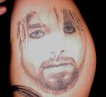 think before you ink a gallery of truly awful band tattoos music galleries tattoos. Black Bedroom Furniture Sets. Home Design Ideas